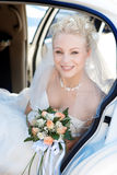 Portrait of the bride in the car Royalty Free Stock Photos