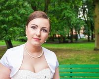 Portrait of a bride in a city park Stock Photography