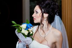 Portrait of the bride close-up with wedding bouquet. Indoor, Studio, interior royalty free stock photo
