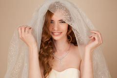Portrait of bride with curly hairstyle and beautiful makeup Stock Photography