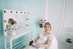 Portrait of bride in flower decor, studio photo. Beautiful Bride portrait wedding makeup and hairstyle, fashion bride model jewelr Royalty Free Stock Photography