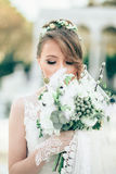 Portrait of Bride With Flowers Stock Image