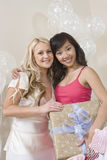 Portrait Of Bride And Friend Holding Gift Stock Image