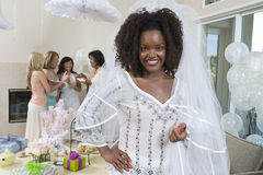 Portrait Of A Bride With Friends In The Background Stock Photo