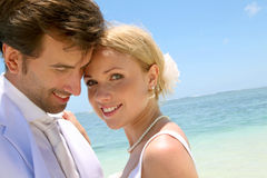 Portrait of bride and groom. Portrait of just married couple on the beach Royalty Free Stock Images
