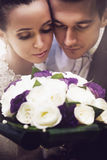 Portrait of bride and groom with bouquet Royalty Free Stock Images
