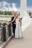 Portrait bride and groom at the bridge Royalty Free Stock Photos
