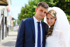 Portrait of the bride and groom on a city street Royalty Free Stock Photo