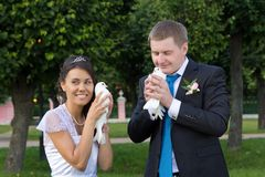 Portrait of bride and groom in the hands of the do Royalty Free Stock Photos