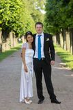 Portrait of bride and groom in the hands of the do Stock Photography
