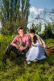 Portrait of bride and groom having picnic at field Stock Image