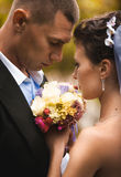Portrait of bride and groom holding bouquet Royalty Free Stock Images