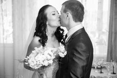Portrait of bride and groom kissing at home Royalty Free Stock Images