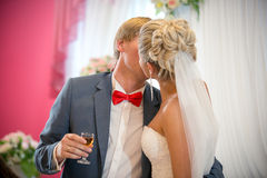 Portrait of bride and groom kissing at restaurant Royalty Free Stock Image