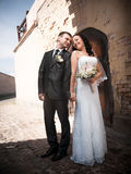 Portrait of bride and groom looking at each other at ancient castle Stock Photography