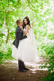 Portrait of the bride and groom in nature, happiness, family, relationships, youth, lifestyle Royalty Free Stock Photo