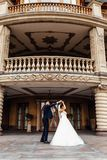 Portrait of the bride and groom near the building, a couple in love stock images
