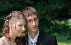 Portrait of bride and groom in summer park Stock Images