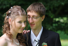 Portrait of bride and groom in summer park Royalty Free Stock Image