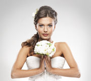Portrait of a bride holding a bouquet of roses Royalty Free Stock Image