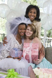 Portrait Of An Bride Holding Gift With Her Mother And Friend royalty free stock images