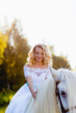 Portrait of a bride on horseback Stock Photo