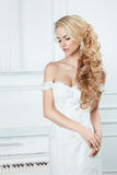Portrait of the bride with long locks. Stock Photography