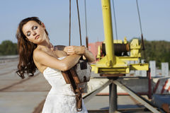 Portrait of bride near hoisting crane. Royalty Free Stock Images