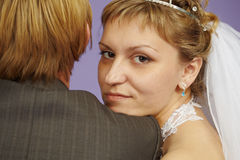 Portrait of bride near to groom Stock Photos