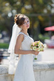 Portrait of bride in park Stock Image