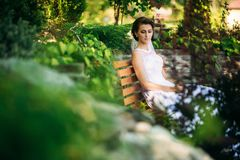Portrait of the bride in the park. Wedding dress. Sunny day.  Royalty Free Stock Photography