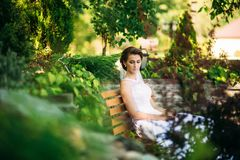 Portrait of the bride in the park. Wedding dress. Sunny day. Love Stock Photos