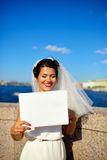 Portrait of a bride with plate on quay Neva river, Saint-Petersburg Stock Photos