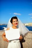 Portrait of a bride with plate on quay Neva river, Saint-Petersburg Stock Photography