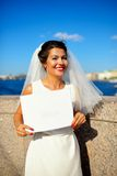 Portrait of a bride with plate on quay Neva river, Saint-Petersburg Stock Photo