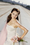 Portrait of bride on the road. Portrait of smiling bride on the road Royalty Free Stock Images