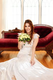 Portrait of bride sitting with bouquet of flowers Royalty Free Stock Photo