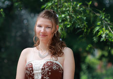 Portrait of bride in summer park
