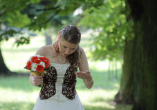 Portrait of bride in summer park Royalty Free Stock Image