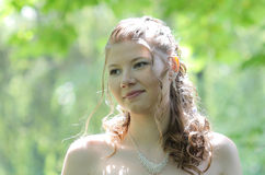Portrait of bride in summer park Royalty Free Stock Photos