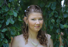 Portrait of bride in summer park Stock Photo