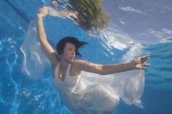 Portrait of bride underwater Stock Photography
