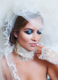 Portrait of bride with a veil and makeup.  Stock Images