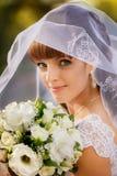 Portrait of bride with wedding bouquet stock image