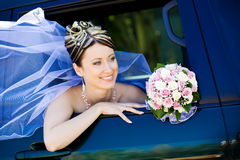 Portrait of the bride in the wedding car royalty free stock photos