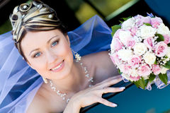 Portrait of the bride in the wedding car Royalty Free Stock Images