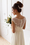 Portrait of the bride in a wedding dress with a bouquet. Bride portrait from the back holding a bouquet Stock Photos