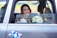 Portrait of a bride in a wedding limousine Stock Images