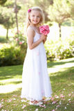Portrait Of Bridesmaid Holding Bouquet Outdoors Stock Photo
