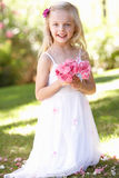 Portrait Of Bridesmaid Holding Bouquet Outdoors Royalty Free Stock Photography